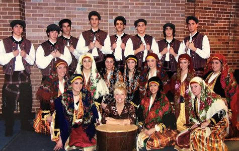 REMEMBERING THE RETIREES: Posing with her dance members for South's 2006 Variety Show, Cindy Pouplikollas (bottom row, second from the left) participates in the Teacher's Act Tradition; Pouplikollas is now retiring after 23 years as P.E. administrative assistant.