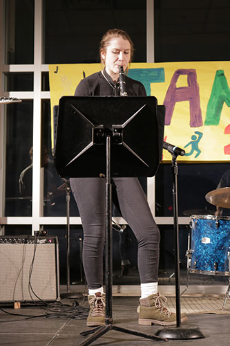 KIRBY IS KILLING IT: Standing on the stage at Jamnesty, Senior Erin Kirby plays her clarinet. Kirby also taught herself how to play the alto saxophone her freshman year.