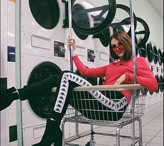 STRIKE A POSE: Lounging in the laundromat (left), junior Amina Mayzel participates in a photo shoot. Mayzel believes it is important to act like your true self even when in front of the camera.