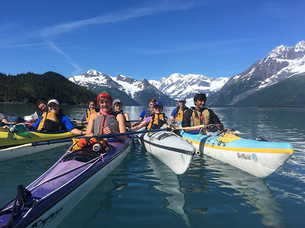 Cool Kayaking:   Kayaking through the Prince William Sound, Junior Ellie Ruos (second from the right) navigates the waters with her friends. Ruos went on a backpacking trip throughout the Alaskan wilderness, with nothing but the untouched world ahead of her. Photo courtesy of Wilderness Adventures