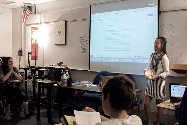 Fresh Faces: Presenting to her sophomore English class, new teacher Jen Jun teaches a lesson on fables. Glenbrook South hired 11 new staff members this school year.