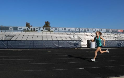 Senior captain Lila Frick practices on the GBS track. The girls cross country team finished third at the Wakanda meet on Sept. 1.