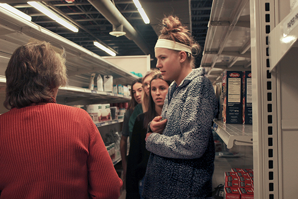 South    Souperheroes: Visiting the Northfield Food Pantry, senior Kate Gregory, student body president, listens to a pantry representative to gauge their food supply levels. The Northfield Food Pantry serves 700 families.