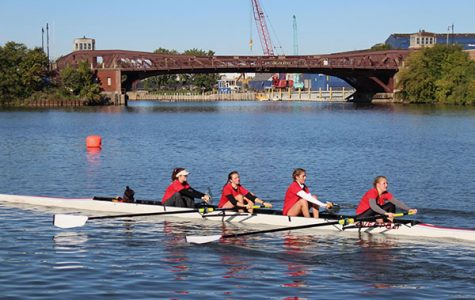 Paddling in sync, South's rowing team passes the Ashland Avenue bridge on the Chicago River during practice.