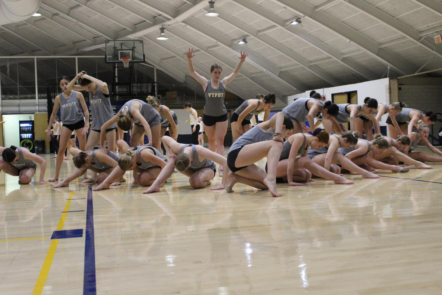 In their ending pose, the varsity Poms team practices their jazz dance routine preparing for their upcoming local competitions as well as National competition in Orlando, Florida.