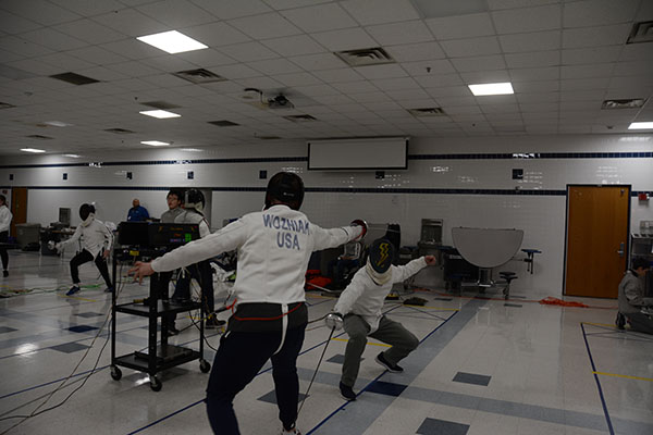Attempting to get a touch, senior Maxwell McWilliams practices his fencing skills.
