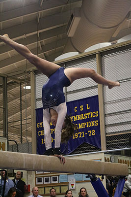 Balancing on the beam, freshman       Stella Khan executes a back walkover. South placed first in the Titan Quad with a score of        142.05.