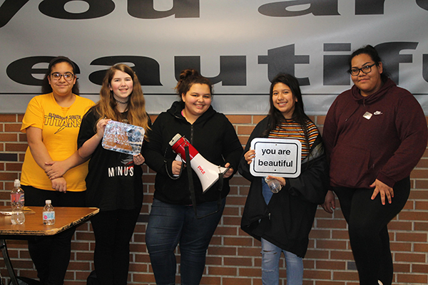 Beautifully built :  Beaming with smiles, (left to right) freshmen Nermeen Abdelgaward, Mya Wagner, sophomore Alina Bergquist, junior Jazmin Montesinos and senior Jenny Vargas advocate for South students to participate in their campaign during lunch blocks. The 'You Are Beautiful' campaign was brought to South by the club Images with the help of SAFE.