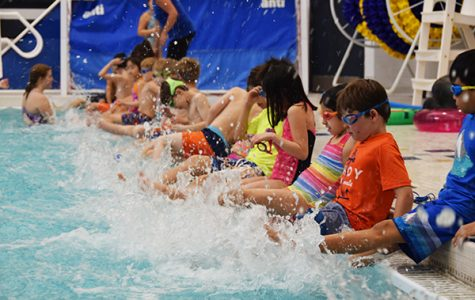 "Splashing Swimmers: Practicing their kicking skills, kids in ""Learn to Swim"" are taught by South students. Founded in 1962, the program helps teach young children how to swim while building leadership skills in South students."