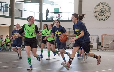 V-I-C-T-O-R-Y: Racing up the court, a member of the Glenbrook United basketball team, the Wolves, dribbles towards the basket. The Glenbrook United Special Olympics Team won four state titles in the four games they competed in on March 15-17. Photo courtesy of Christian Lantry