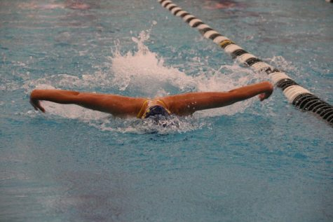 Swimming To Success: Flying to the finish line, junior Mia Kriltchev, girls varsity swimmer aims for victory at the South swim meet against Fremd. South beat Fremd with a final score of 95-93 on the varsity level.