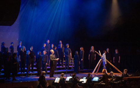 """Solemn singing: Singing on Ravinia's stage, Conspirare performs the song """"The Fence (That Night)"""" about the night Matthew Shepard spent the last hours of his life tied to a fence. South's Chambers Singers performed soon after. Photo courtesy of Ravinia"""