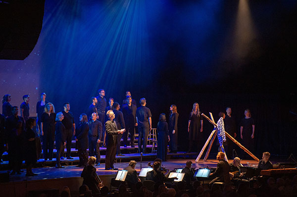 "Solemn singing: Singing on Ravinia's stage, Conspirare performs the song ""The Fence (That Night)"" about the night Matthew Shepard spent the last hours of his life tied to a fence. South's Chambers Singers performed soon after. Photo courtesy of Ravinia"