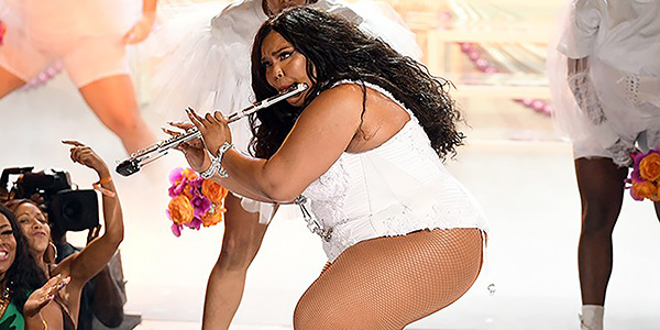 Loving Lizzo: Playing her flute at the BET awards, Lizzo flaunts her musical talents. Her flute can be found in multiple songs throughout her album.