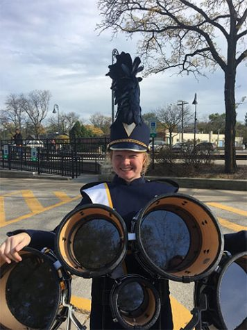 Booming with a smile at last year's homecoming parade in downtown Glenview, Clare Dunne Murphy celebrates a successful performance with the marching band.  Photo courtesy of Claire Dunne Murphy