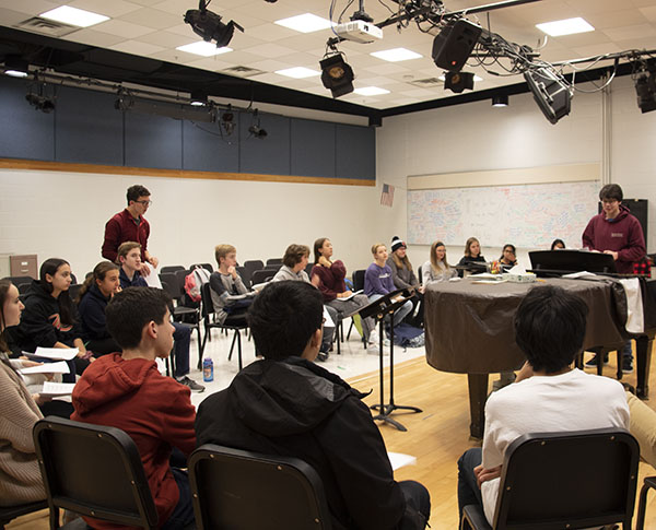 Teaching the youngsters: Helping middle schoolers learn a capella, seniors Ben Kalish (standing left) and Brian Destefano (standing right)    share their knowledge to make the transition into high school choir easier. The kids have an opportunity to prepare for South's choir.