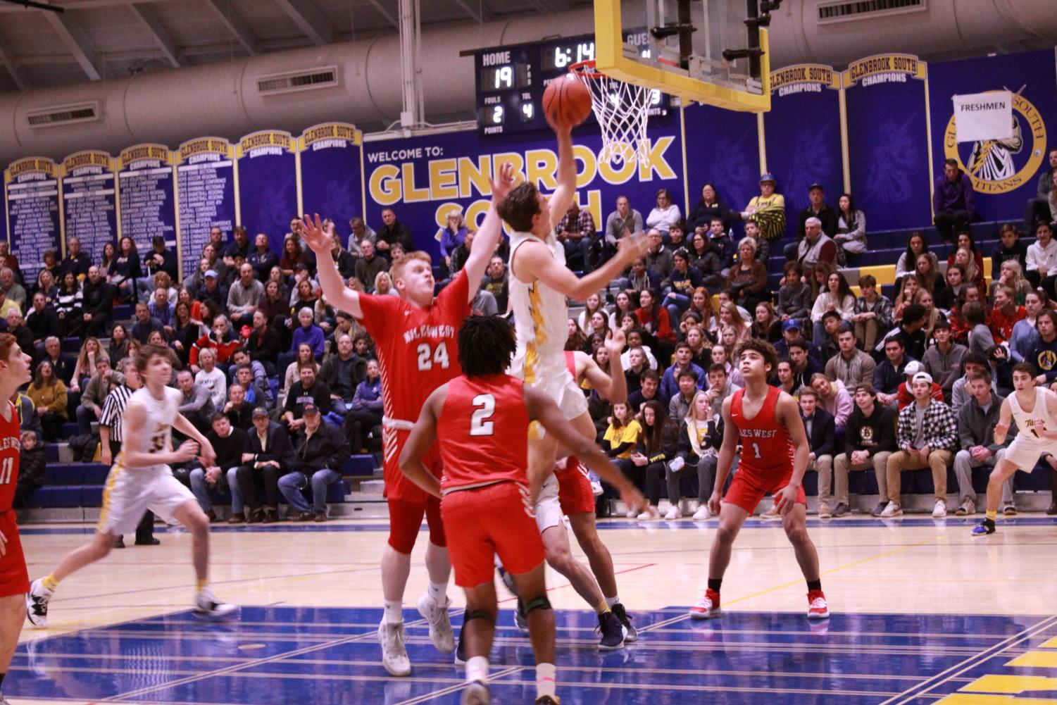 Bringing in Baskets: Jumping to the basket, senior Dominic Martinelli goes for the shot following senior Joe Shapiro's injury on Dec. 13. South won 66 - 35 against Niles West. Photo by Nicole Surcel