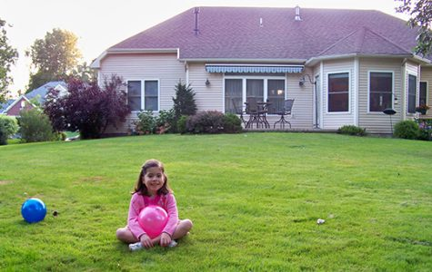 Sweet Carolina: Posing for the camera, Carolina, 5 years old, sits in New York, outside her fifth home. She moved two times after this, residing in a total of seven homes. Photo courtesy of Carolina Rodriguez