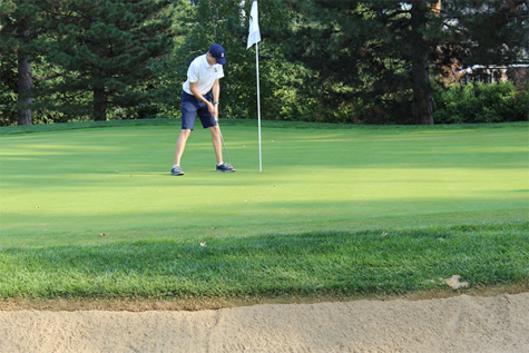 Putting Professional: Working on his putting game, senior Captain Sam Collett is trying to keep his team close despite the chaos of the season during a pandemic.