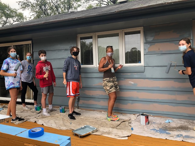 Altruistic Artists:  Socially distanced, Interact members participate in their yearly Paint-A-Thon. Both Interact and Key Club have found safe ways to help out in their community during the pandemic. Photo courtesy of Grace Cullum.