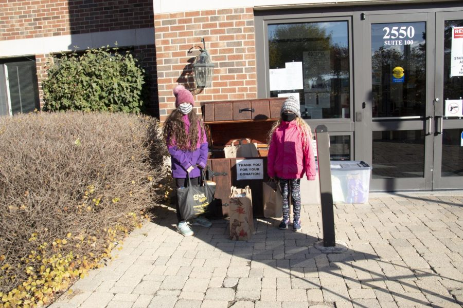 Helping Hands: Dropping off donations, members of the Glenview community show support for South's canned food drive. All items can be dropped off at the front entrance of the school.