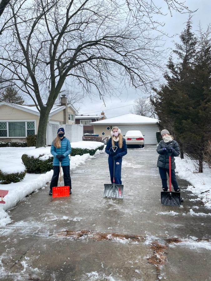 Sweet Students: Persevering through icy tempuratures and snow-covered driveways, juniors Elise Bauerschmidt, Elle Milek and Bella DeRosa (left to right) help out senior citizens through the Snow Angels Program. Photo courtesy of  Grace Cullum
