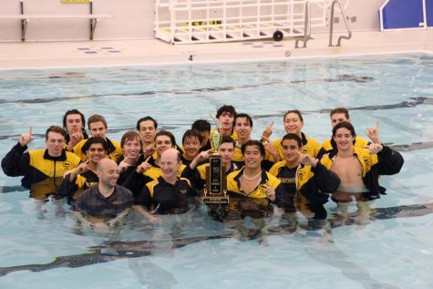 Stand-out Swimmers: Posing with the state championship trophy in the GBS pool, the boys' swim team completed the tradition of a celebratory dive with the state trophy on April 9. The team was celebrated for their first state championship in program history earlier in the night during South's home football game against Maine South.