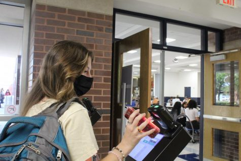Scanning Success: Junior, Fiona Clements scans her phone to check in at the kiosk.