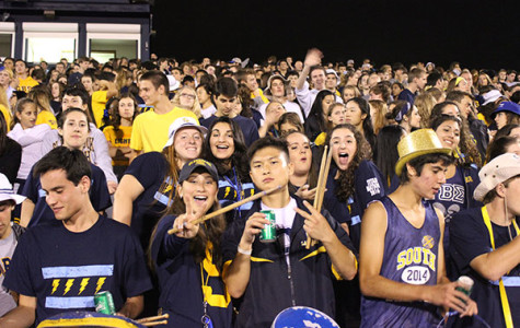 BACK-TO-SCHOOL SPIRIT: Cheering on the varsity football team at their first home game, students demonstrate their school pride. Titan Nation's presence is more appropriate at football games than in the GBS hallways.