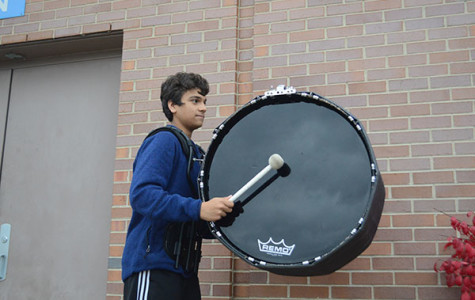 Drumming Dude: While marching in band practice, freshman Amil Dravid scans ahead towards his fellow drumline mates to stay in formation.  Photos courtesy of Amil  Dravid