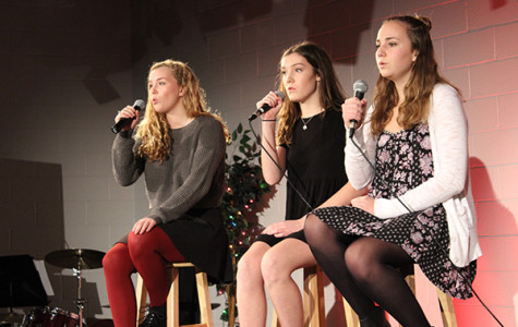 """GIRLS 'N SYNC: Singing the song """"Mind Over Matter,"""" sophomores Katharine Springer, Claire Valenziano and Lily Reighard participate in the This 'n That Coffee House. The event allowed students, who normally don't get many chances to perform, to sing in a casual environment in the choir room."""