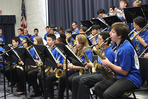 """GET JAZZY: Performing with the Glenbrook South Jazz Lab,  junior Kayleigh Markulis, freshman Gus Morales and sophomore Jonah Frese (front) entertained the audience and judges with their saxophones at the Jazz Festival. Their group performed  """"Morning Funk,"""" """"Vita Bella"""" and """"The Groove."""""""