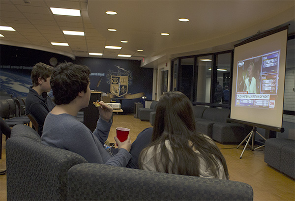 LATE-NIGHT LEARNING: While snacking and socializing, students seeking to be politically informed watch CNN coverage of ìSuper Tuesday,î the first round of presidential primary elections. The event, held in the SAC, was hosted by Young Democrats Club on March 1.