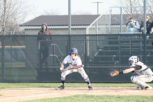 BEATIN THE BALL: Eyes on the ball, junior Cameron Pauly, prepares to bunt.