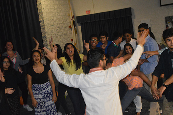 DESI DANCE: Attracting the attention of other dancers, senior Jeffery Kurian's energy spreads enthusiasm amongst his peers as they dance to Bollywood music. Desi Club hosted its first Bollywood dance night to fundraise for a non-profit school in New Delhi and Dara Dune, India.
