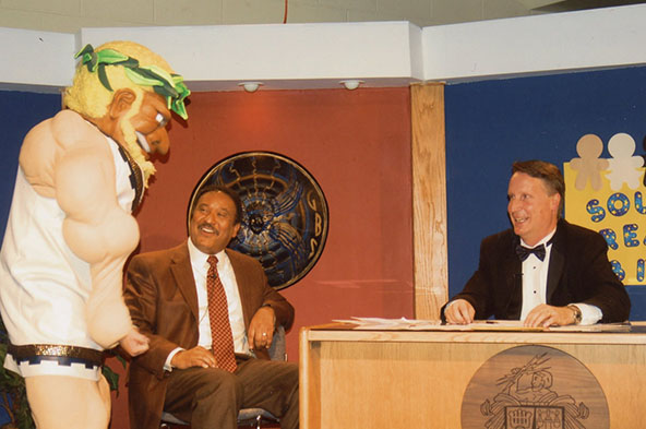 THE TITAN IN ALL OF US:  GBS alumnus Jake Schmidt interacts with former WBBM weatherman Steve Baskerville (left) and Dr. Jim Shellard (right) while dressed up as Tommy the Titan during the 2011 South Telethon. Schmidt, an active member of Student Council, was a part of South's Special Education Department.