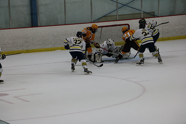 Bending down to block out the shot, goalie Paul Zygmunt makes the save against a Loyola Gold offender. The Titans lost to the Ramblers by a score of 4-2.