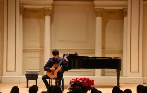 Jammin' Jeremiah: Performing at an event, junior Jeremiah Yang plays the classical guitar in front of an audience. According to Yang, he plays mostly classical pieces on the guitar.