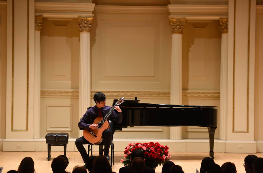 Jammin%27+Jeremiah%3A+Performing+at+an+event%2C+junior+Jeremiah+Yang+plays+the+classical+guitar+in+front+of+an+audience.+According+to+Yang%2C+he+plays+mostly+classical+pieces+on+the+guitar.+