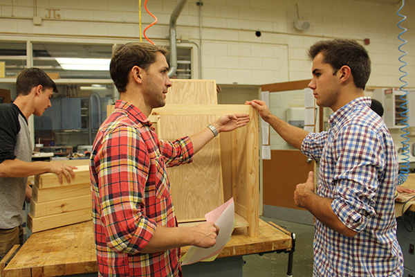 Supervising Silca: Woodworking teacher Stephen Silca provides insight on senior Jeffrey Mitchell's woods project. Silca has been teaching woodworking at South for five years.