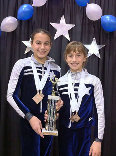 Smiley sisters: Posing with their trophy, sisters Hannah (age 11) and Jenna (age 9) Hartley, celebrate their second place finish in the all-around event at the Make a Wish Classic in 2011.