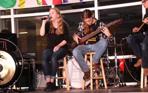 Mindful music: Playing on stage, junior Megan Heublen, sophomore Jack Sundstrom (left) and junior Jack Quinones (right) perform at Jamnesty, April 13. The students contributed to the show and to peace week, raising awareness and playing music.