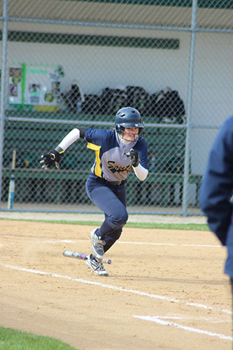 Sprinting to first base, Kuhn looks to make a run against Vernon Hills her sophomore season in 2015. Kuhn will continue her success on the field at Indiana University, according to Kuhn.