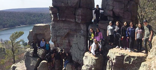 Happy Hikers: Smiling at the camera, GBS Outdoors Club member pose during their hike at Devil's Lake State Park. The club was created this past Fall, and they took their first trip to Devil's Lake on April 8. Photo courtesy of Christina Moy