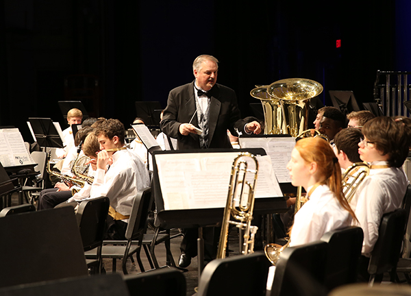 Graduating Greg:  Leading South's band members, Greg Wojcik, head band director, prepares to conduct his final concert at South. Wojcik has been a member of the Titan family for 38 years and is retiring this year.