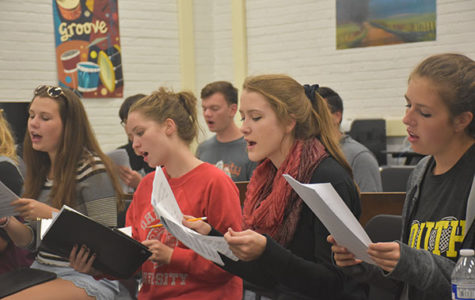 CHIMING CHAMBERS: Singing intently, (from left to right) juniors Steph Ornduff and Becky Jacobson, along with seniors Erin Kirby and Rachel Shwartz, prepare for future shows they will perform in within their a capella group, Chambers. This ensemble is best known for their old fashioned clothing and seasonal songs.