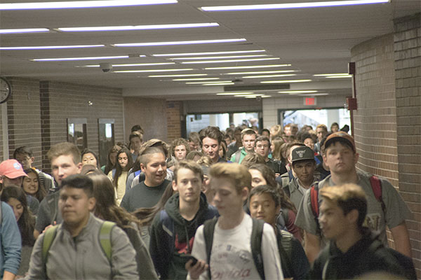 CROWDED CORRIDORS: Walking down the busy hallway as the bell rings at 3:15, South students make their way through the mob. South's student population has been increasing over the last few years and the district has been making accommodations for this increase.