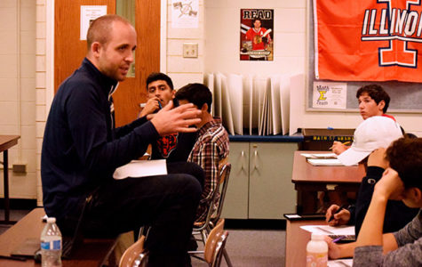 COPE IN CHARGE: Addressing a room full of engaged students, math teacher Bryan Cope exlains a complex concept . Before recieving Glenbrook South's Distinguished Teacher Award in 2017, Cope taught at South for 13 years and imparts knowledge as well as life lessons to his students.