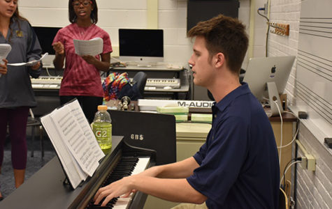 SINGING SHELLARD: Playing the piano for South's choir group Chambers, new co-choir director Robert Shellard helps students to improve their vocals. Shellard himself was a part of Chambers prior to his graduation in 2009.