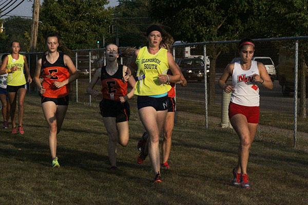 Running towards the finish line, Senior Megan Kennedy finished a cross country meet.